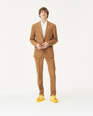 How to wear: black socks, yellow leather low top sneakers, white dress shirt, tan suit