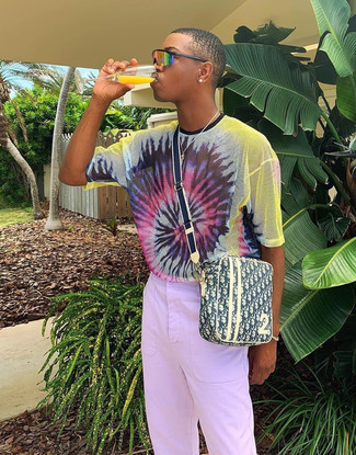 How to wear: orange sunglasses, yellow print canvas messenger bag, light violet chinos, multi colored tie-dye crew-neck t-shirt