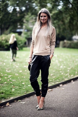 How to wear: silver watch, yellow horizontal striped leather pumps, black leather sweatpants, beige v-neck sweater