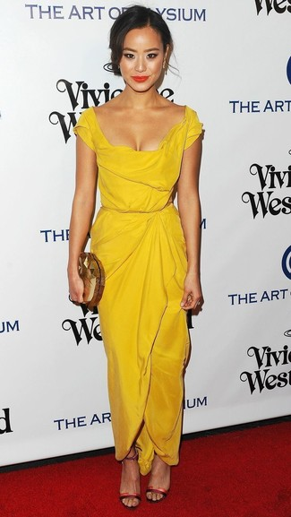 Jamie Chung wearing Yellow Sheath Dress, Red Leather Heeled Sandals, Gold Clutch, Gold Earrings