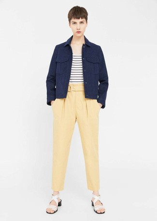 How to wear: white leather heeled sandals, yellow tapered pants, white and black horizontal striped crew-neck t-shirt, navy military jacket