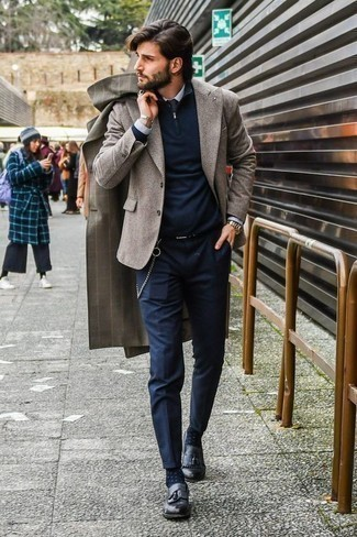 How to Wear a Navy Zip Neck Sweater For Men: The mix-and-match capabilities of a navy zip neck sweater and navy chinos mean they will stay on regular rotation in your menswear arsenal. If you want to break out of the mold a little, introduce a pair of black leather tassel loafers to the mix.