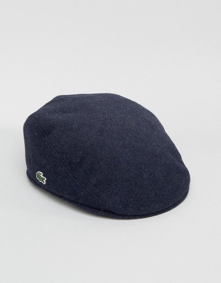 d502e7cb0a5 ... spain lacoste flat cap in navy 48f8b 02354