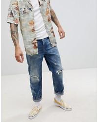 ASOS DESIGN Skater Jeans In Dark Wash Vintage Blue With Rip And Repair