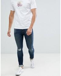 ASOS DESIGN 125oz Super Skinny Jeans In Dark Wash Blue With Knee Rip