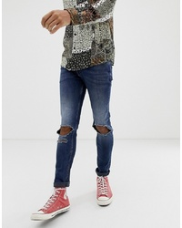 ASOS DESIGN Skinny Jeans In Overdyed Blue With Open Rips