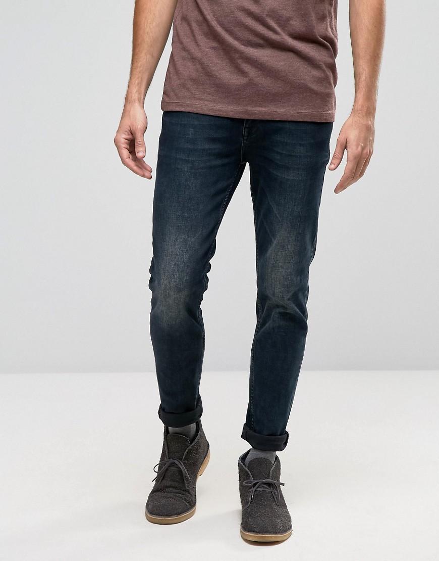 ASOS DESIGN Skinny Jeans In Blue Black Wash