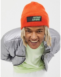 ASOS DESIGN Oversized Beanie In Orange With Rubber Badge Detail