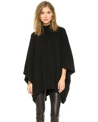 Dress in black leggings and a poncho for an easy to wear look.