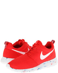 Red and White Athletic Shoes