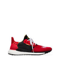 sports shoes 1c4f5 db28a ... adidas Red And Black X Pharrell Williams Solar Hu Glide St Sneakers