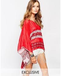 Spiritual hippie poncho top with v neck tassel details medium 348563