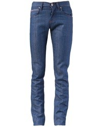 Pairing a blue denim shirt with slim jeans is a comfortable option for running errands in the city.