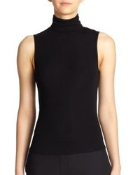 Consider teaming an army green pencil skirt with a sleeveless turtleneck for a sleek elegant look.