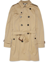 Marry olive cord jeans with a trenchcoat if you're going for a neat, stylish look.