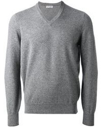 This combination of olive green cord jeans and a v-neck sweater is perfect for off-duty occasions.