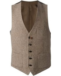 Pairing a dark brown overcoat and a waistcoat will create a powerful and confident silhouette.
