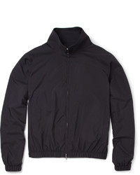 A dark grey rollneck and a windbreaker are great staples that will integrate perfectly within your current looks.